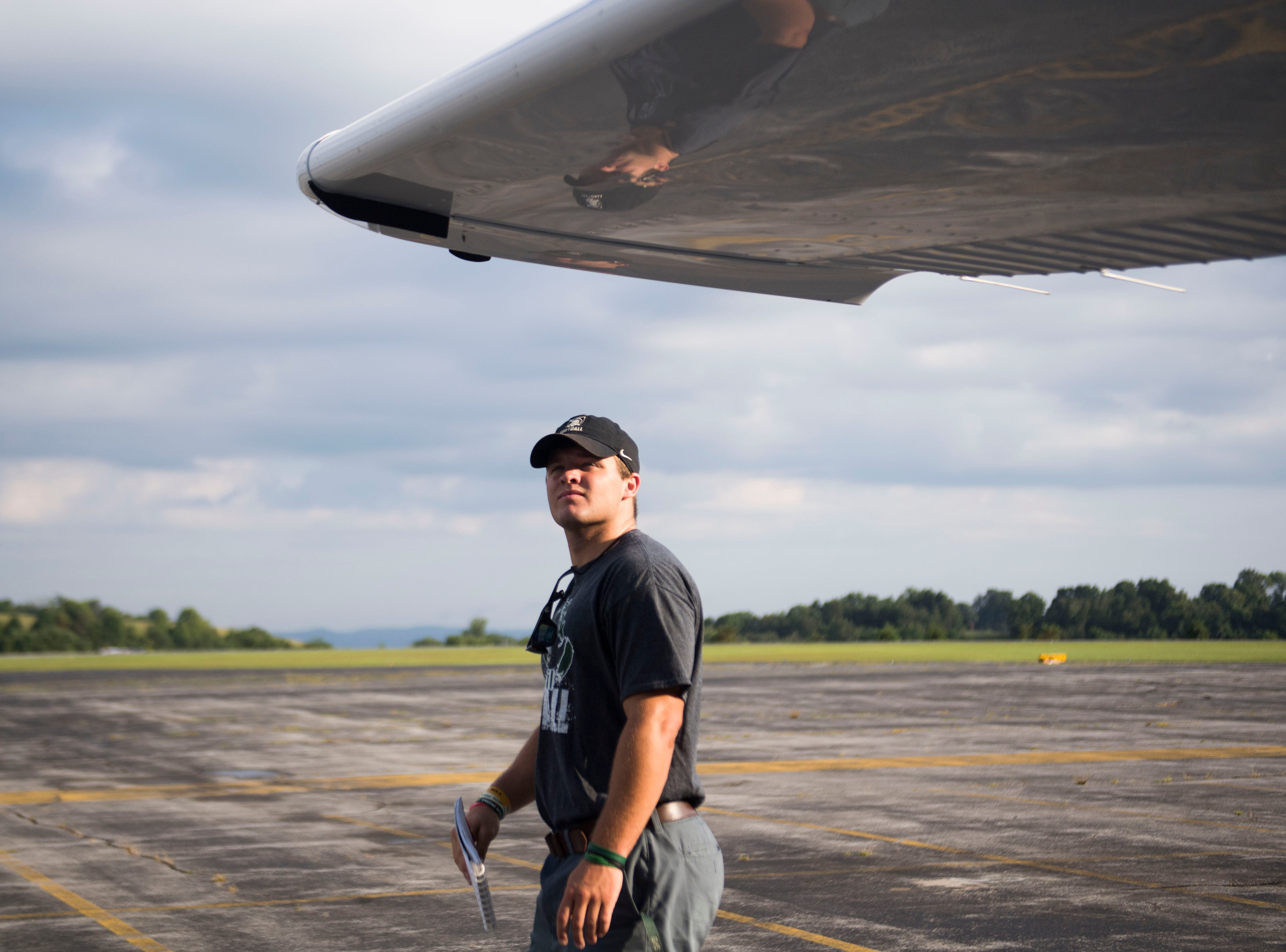 Greeneville quarterback Cade Ballard does a preflight check at the Greeneville-Greene County Municipal Airport, Wednesday, Aug. 8, 2018.