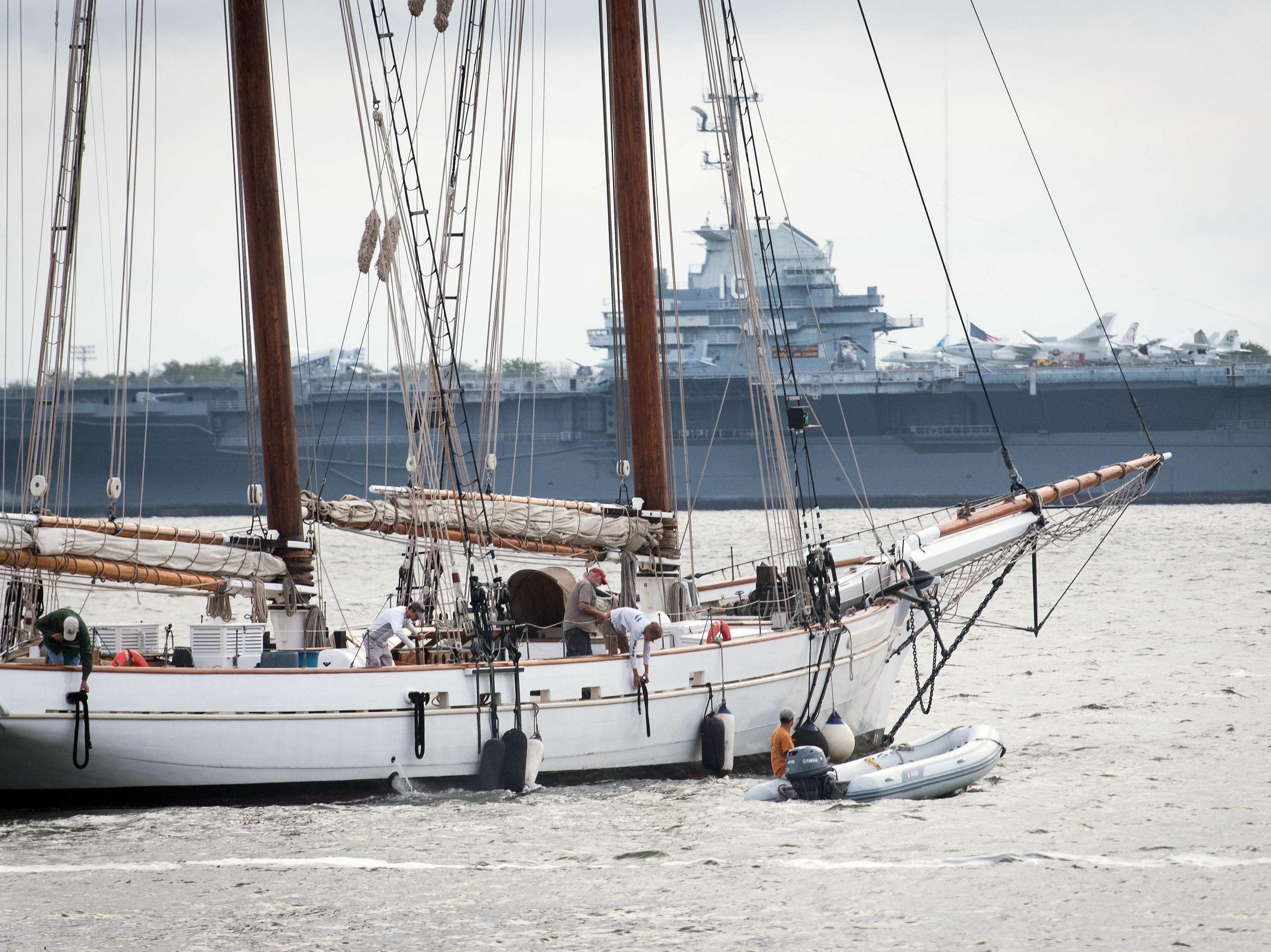 September 13, 2018; Charleston, SC, USA; The 140 foot Spirit of South Carolina schooner makes way heading upriver to find a safe location away from Charleston before Hurricane Florence makes landfall along the East Coast. The USS Yorktown aircraft carrier is seen in the background.