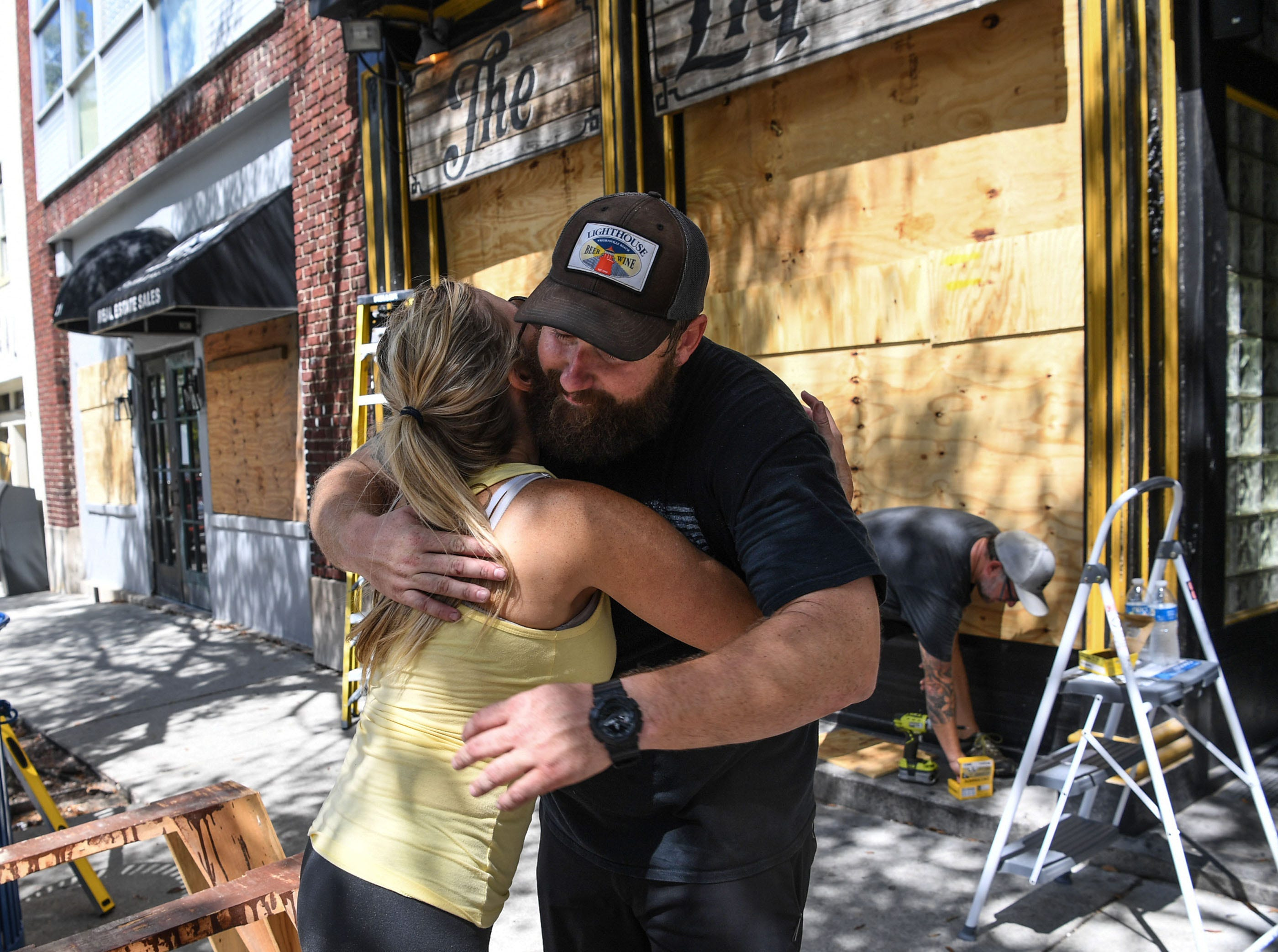 Sep 12, 2018; Wilmington, NC, USA; Jennifer Wilson gives a hug to Andy Correll at The Liquid Room, a bar near the riverfront in Wilmington before the arrival of Hurricane Florence.