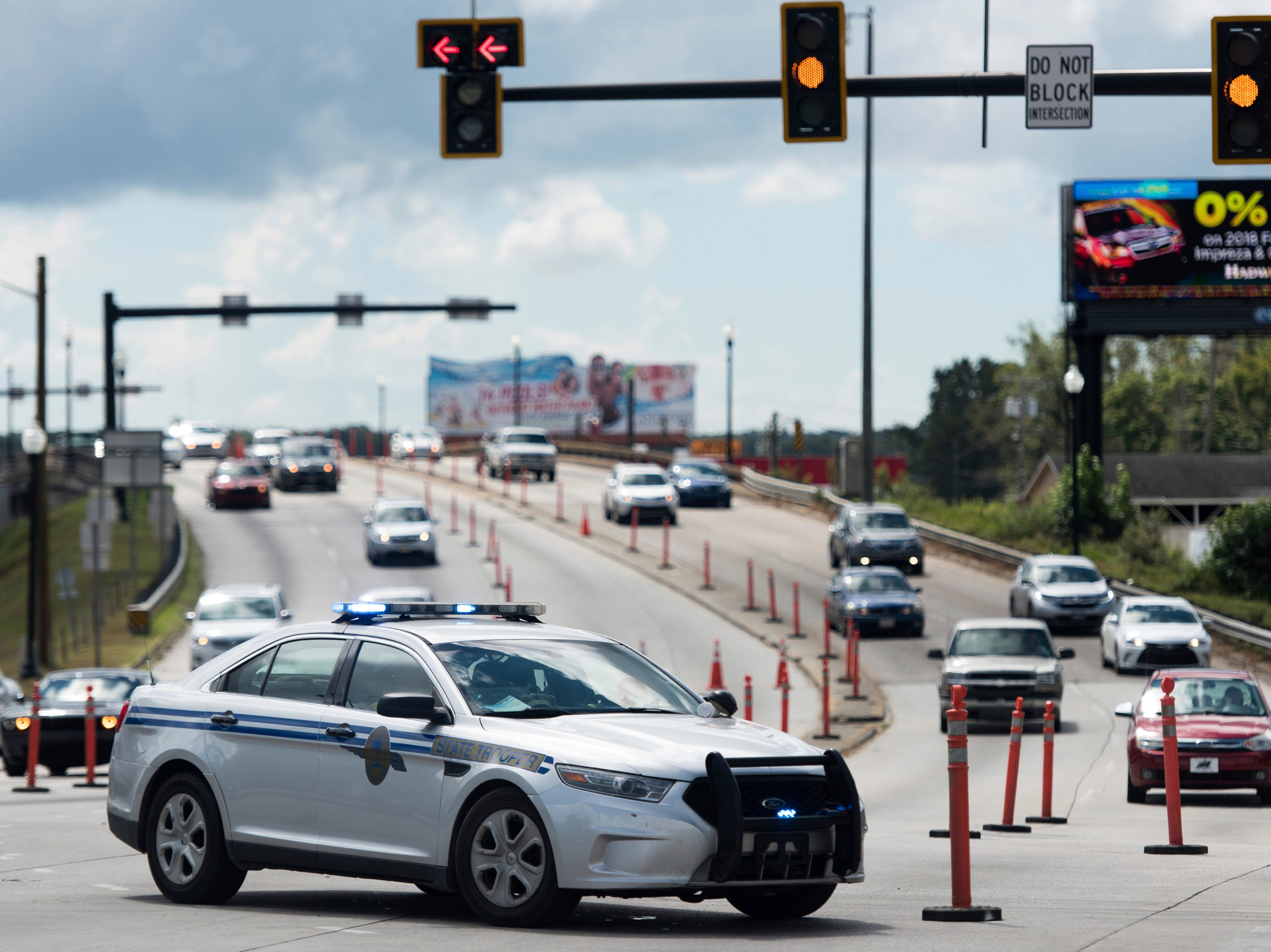 A South Carolina state trooper directs counterflow traffic traveling west from Myrtle Beach on U.S. 501 as Hurricane Florence approaches the East Coast, Wednesday, Sept. 12, 2018, in Conway, S.C.