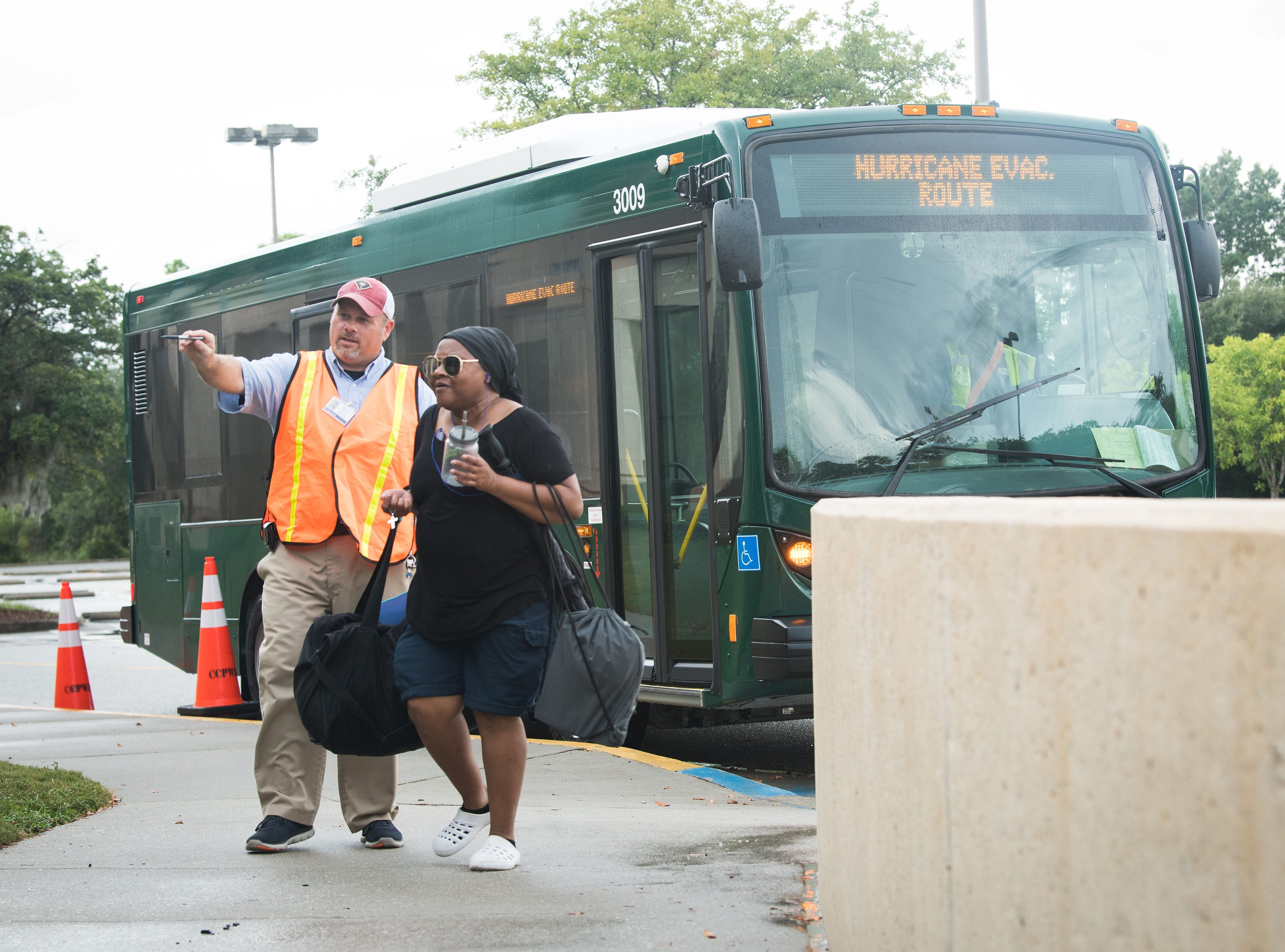 Sep 12, 2018; Charleston, SC; Charleston County's Adam Coleman directs people arriving at the Charleston County Government Complex to be evacuated on buses to locations further inland such as Columbia, SC prior to Hurricane Florence making landfall along the East Coast.