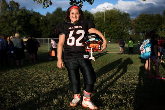 Ava Wooten, 9, of Powell, is the only girl on her 9U Powell Youth football team. 09.11.18