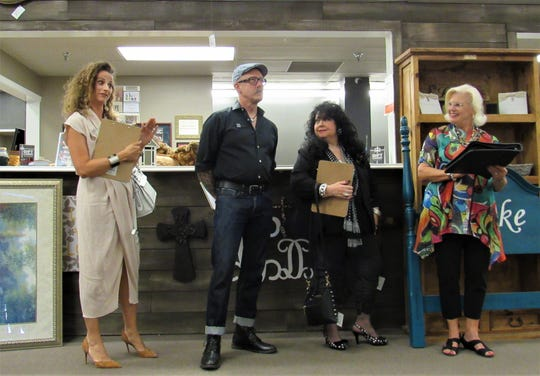 Professional designers volunteered as judges; Natalie Clayman, Jeff Heiskell and Sylvia McCormack were introduced by event coordinator Judy Gooch (right).