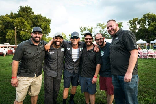 """Sharp Emmons (center) and his team, including Rhizome Productions' founder Matt Leff (third from right), at """"Red White and Zoo,"""" their 2017 collaboration with the Nashville Zoo. July 28, 2017."""