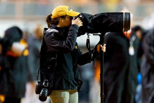 News Sentinel photographer Caitie McMekin takes photos at a University of Tennessee football game against LSU in Neyland Stadium Saturday, Nov. 18, 2017.