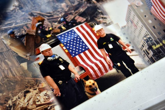 Officer Joe Henderson, left, and his dog, Max at the site of the World Trade Center in New York, September 2001. After working together for 10 years, Max was suffering from a slipped disc and Henderson was devastated to have to put his partner down.