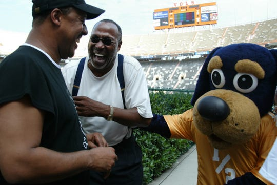 Former Tennessee players Wilbert Jones, left, a defensive back who lettered in 1978-80, and Lester McClain, a wingback who lettered from 1968-70, share a laugh with a UT mascot in 2004 at Neyland Stadium. The two were attending UT's first Letterman's Reunion being held over the Labor Day weekend.