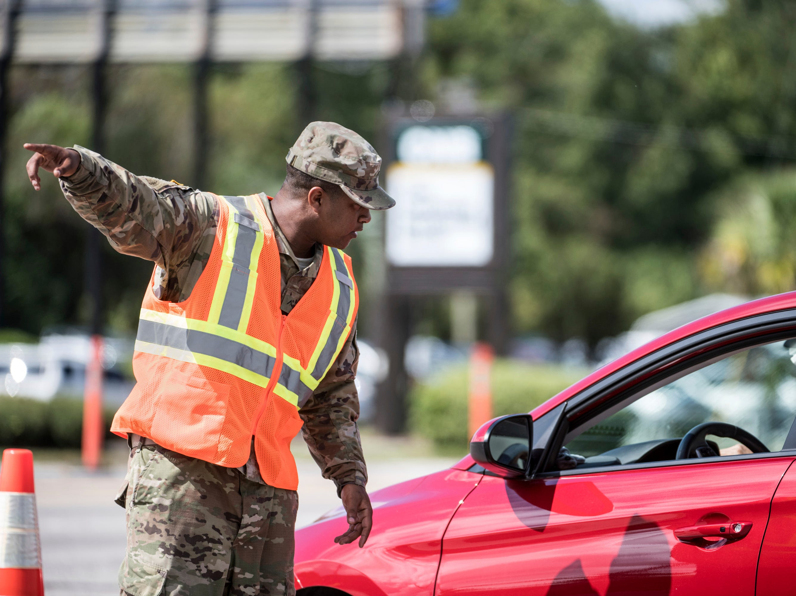 A National Guardsman directs traffic onto U.S. Highway 501 as Hurricane Florence approaches the East Coast Wednesday, Sept. 12, 2018, near Conway, S.C. Time is running short to get out of the way of Hurricane Florence, a monster of a storm that has a region of more than 10 million people in its potentially devastating sights.
