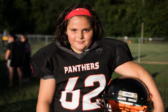 Ava Wooten, 9, of Powell, who plays 9U Powell Youth football, is the only girl on her team. 09/11/18