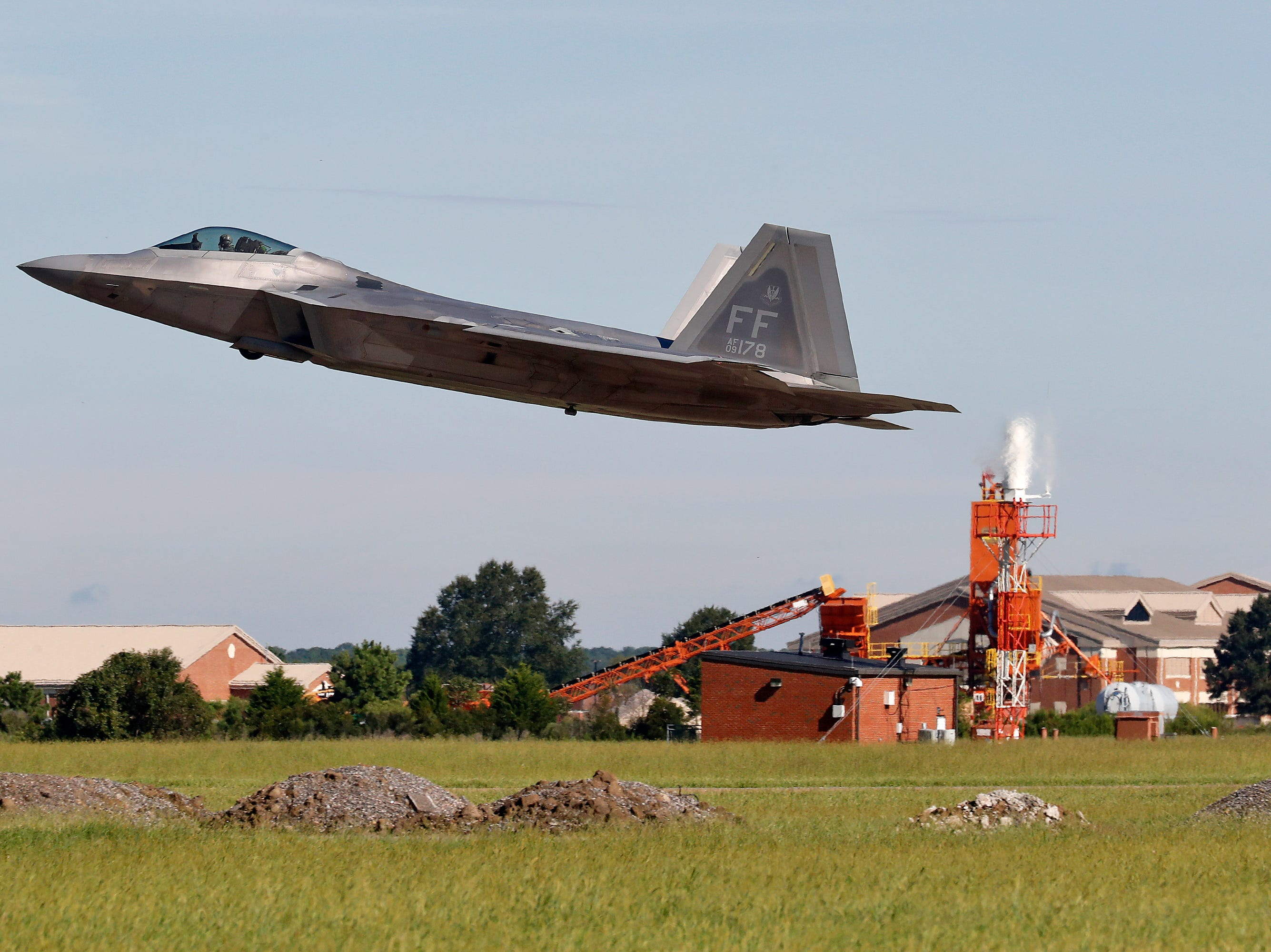 An F-22 departs Langley Air Force Base, Va., Tuesday morning, Sept. 11, 2018, as Hurricane Florence approaches the Eastern Seaboard. Officials from Joint Base Langley-Eustis in Hampton said the base's F-22 Raptors and T-38 Talon training jets, as a precaution, were headed for Rickenbacker Air National Guard Base in central Ohio.