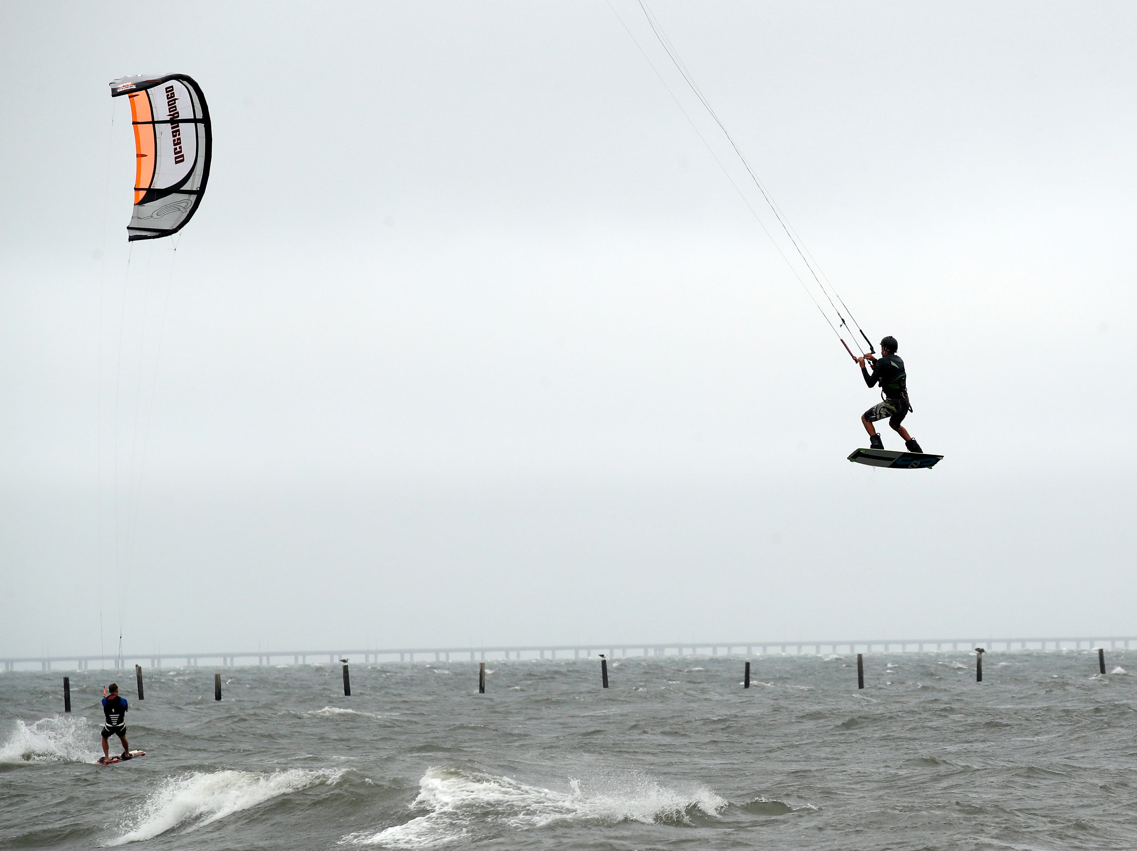 Bob Bowman, from Virginia Beach, Va., gets some air as he kiteboards, Thursday, Sept. 13, 2018, in Virginia Beach, Va., as Hurricane Florence moves towards the eastern shore.