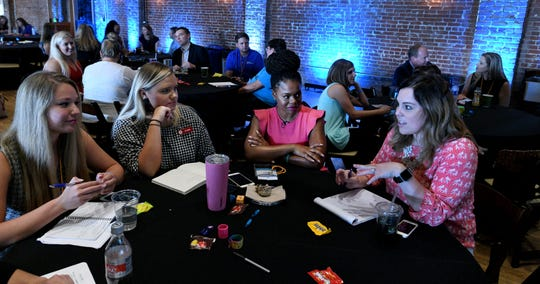 Maria Antoinette, center, sits with one table in her breakout session at the 2018 Endeavor Summit at The Mill and Mine on West Depot Ave. Thursday, September 13, 2018.