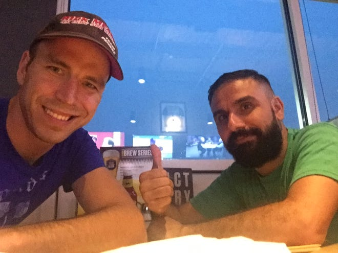 Tommy Blackburn and Ahmed Mardinly in happier and safer times in the United States. Blackburn, a Purdue ROTC graduate, and Mardinly, an Iraqi national, served together in Mosul, where Mardinly was Blackburn's interpreter. Mardinly becomes a United States citizen Friday.