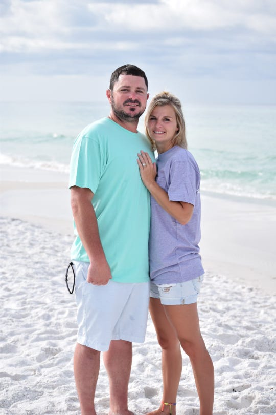 Trish Wise, 32, is pursuing an associate's degree in nursing at Northwestern State University. She is pictured on the beach with husband Justin.