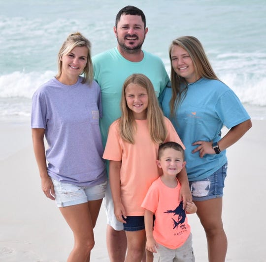 Trish Wise, 32, is pursuing an associate's degree in nursing at Northwestern State University. She is pictured on the beach with husband Justin and their children Victoria, Sydnie and Jayce.