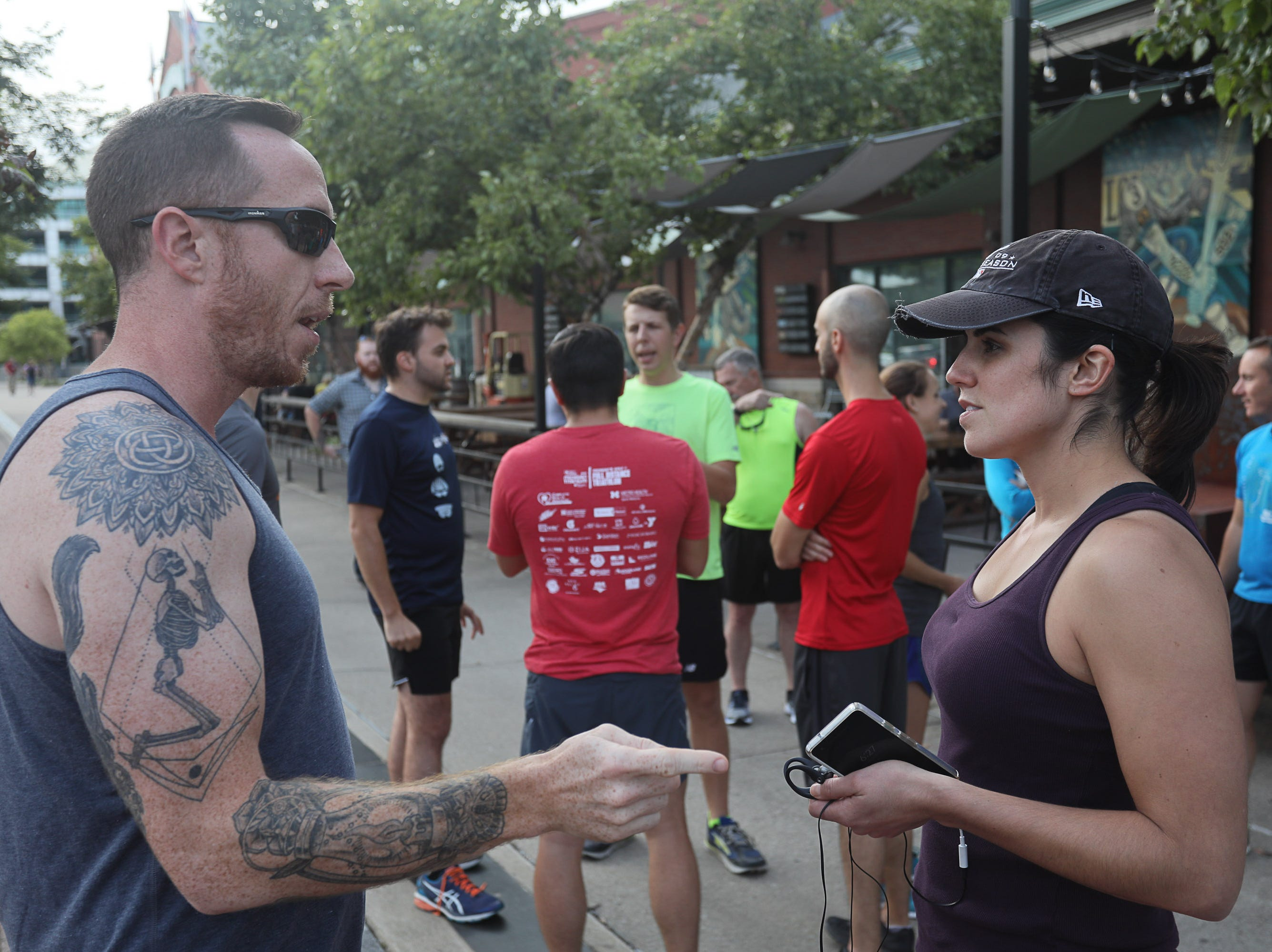 Dan Heath and Lisa Pension during a Derby City Run Club event at Against the Grain Brewery in Louisville, Ky. Sept. 12, 2018