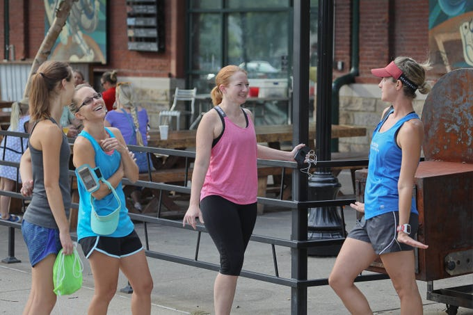 Virginia White, Jill Adams, Ayryn Chilton, and Stephanie Fish during a Derby City Run Club event at Against the Grain Brewery in Louisville, Ky. Sept. 12, 2018
