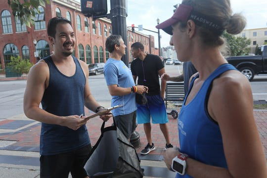 Jason Kelly and Stephanie Fish during a Derby City Run Club event at Against the Grain Brewery in Louisville, Ky. Sept. 12, 2018