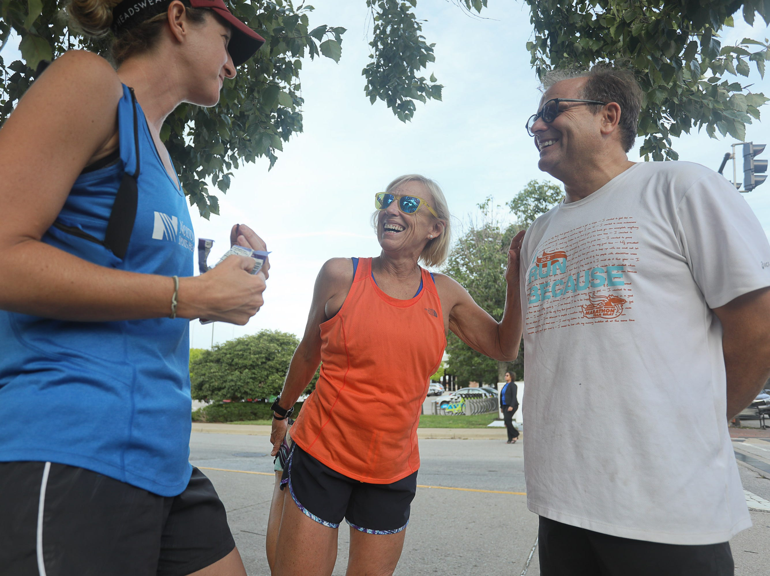 Stephanie Fish, Courier Journal reporter Kirby Adams, and John Grantz during a Derby City Run Club event at Against the Grain Brewery in Louisville, Ky. Sept. 12, 2018