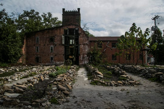 The remains of the old Warehouse A. The Old Taylor Distillery was built in 1887 by Colonel EH Taylor. He made the distillery grounds  have a castle look with european-inspired designs as well as a springhouse modeled after a Grecian bathhouse. After Taylor died at the age of 93 and the distillery being sold off several times before it was  abandoned in 1972. Two owners, Wes Murry and Will Arvin, purchased the 113 acre property outside the city of Frankfort, Ky in 2014.