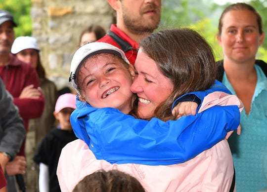 Paige Radebach of Webberville celebrates with her mother, Jamie, after being announced overall winner of the Girls 7-9 age group during a regional round of Drive, Chip and Putt Championship at Muirfield Village Golf Club on September 8, 2018 in Dublin, Ohio.