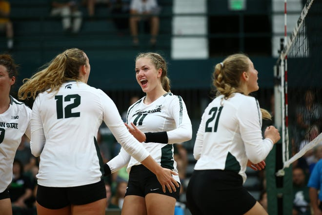 Sophomore Alyssa Chronowski celebrates a point with freshman Elena Shklyar during MSU's Green-White scrimmage at Jenison Fieldhouse. The Spartans are at home for the first time all season this weekend for the Spartan Invitational.