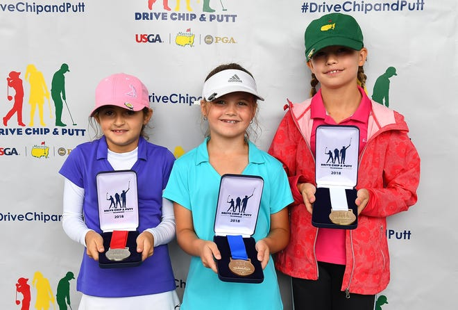 Paige Radebach of Webberville, middle, was the girls 7-9 age group overall winner during a regional round of Drive, Chip and Putt Championship at Muirfield Village Golf Club on September 8, 2018 in Dublin, Ohio.