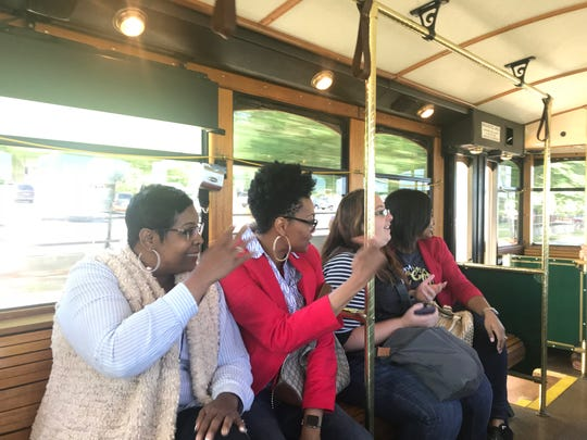 State workers Mable Shields, Felicia Tucker, Brandy Whittington and Alicia Edwards chat with co-workers after lunch on the Grab & Go trolley Sept. 11, 2018.
