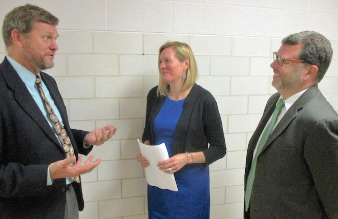 Howard Walters, left, an education professor at Ashland University, discusses his role as external evaluator of the 21st Century grant's effectiveness, with Holly Christie, Mansfield City Schools' director of student support programs, and Stephen Rizzo, the district's chief academic officer.