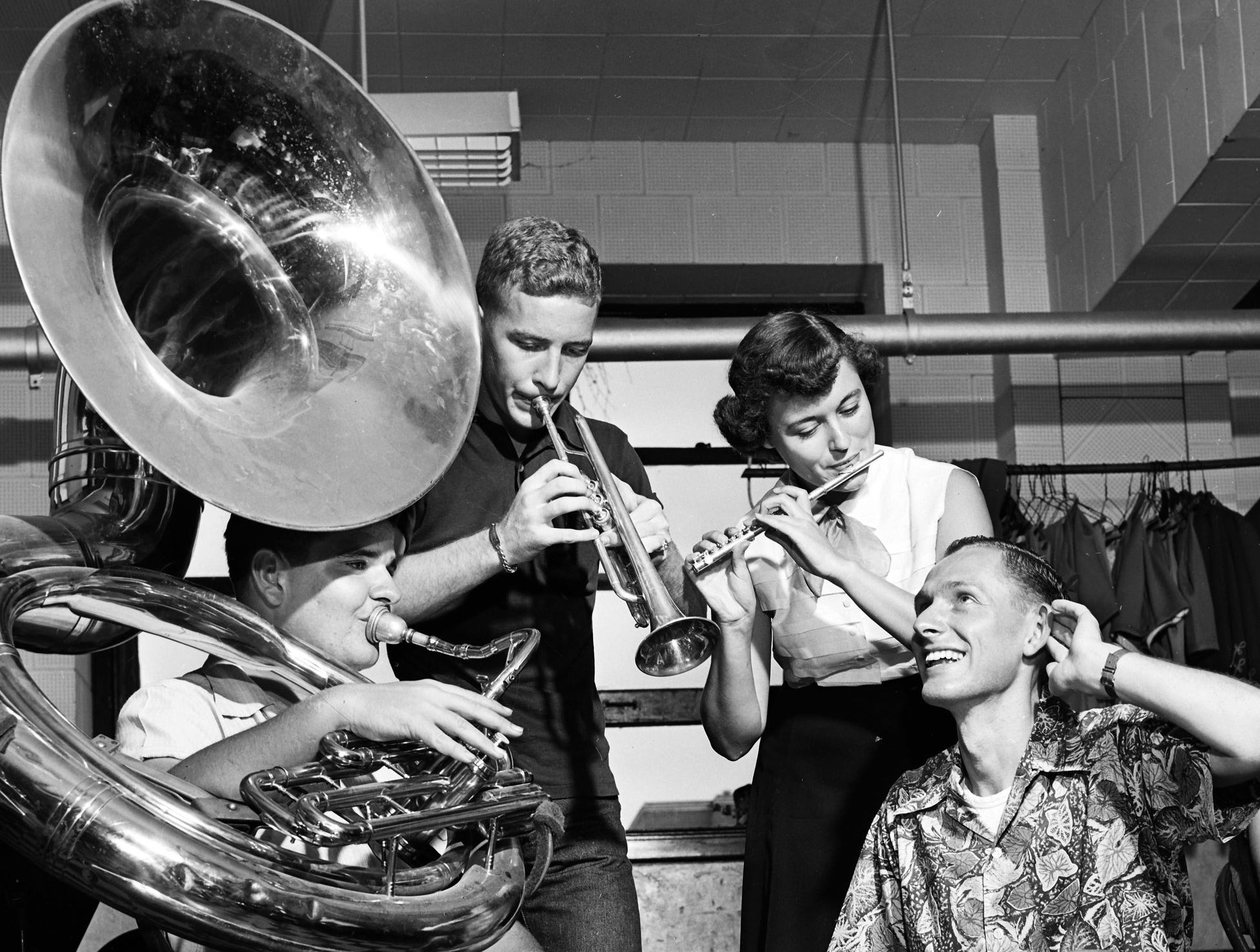First rehearsals of the Memphis State Tiger band, in preparation for the Tigers' opening football game with Ole Miss were held on 15 Sep 1952 and Ralph G. Hale (Right), band director, called for all-out harmony.  Band members sounding off are (From Left), Dan McHugh of 1270 Peach, a freshman; Jackie Jones of Caruthersville, MO, a freshman; and Pat Campbell of 697 North McLean, a sophomore.