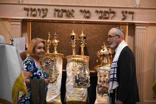 Congregation members unveil the Torah scrolls during the service. Rosh Hashanah, the Jewish New Year, was celebrated at the Jewish Congregation of Marco Island in ceremonies on Sunday evening and Monday morning.