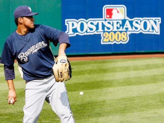 Milwaukee Brewers pitcher Yovani Gallardo warms up in the outfield during the baseball team's workout Tuesday, Sept. 30, 2008, in Philadelphia. Gallardo will start when the Brewers face the Philadelphia Phillies in Game 1 of the National League division series Wednesday in Philadelphia. (AP Photo/Tom Mihalek) ORG XMIT: PATM106