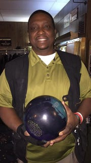 Tyrone Morris, shown in 2016, had a heart pump installed in a way that the wires connecting to a battery exited his body on the left side, freeing his right arm for bowling.