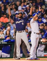 Lorenzo Cain gestures toward the Brewers dugout after his run-scoring hit gave Milwaukee a 1-0 lead in the top of the first inning against the Cubs on Wednesday night.