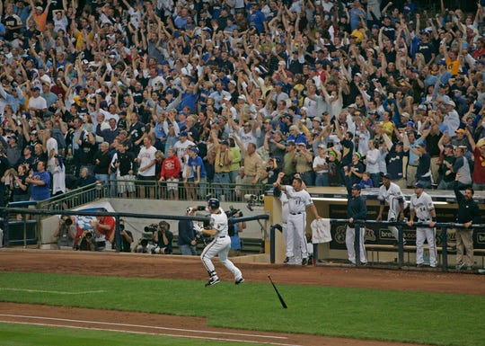Ryan Braun leaps in the air touching off a frenzy with fans after his game winning homerun in the 8th inning Sunday, Sept, 28, 2008.