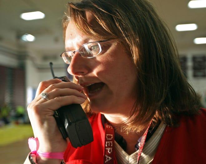 Menomonee Falls Police Chief Anna Ruzinski talks on a portable radio in the Menomonee Falls High School gym during a crisis event exercise in 2010.