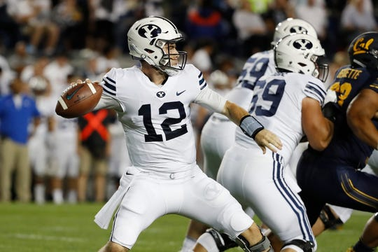 Brigham Young Cougars quarterback Tanner Mangum drops back to pass against California.