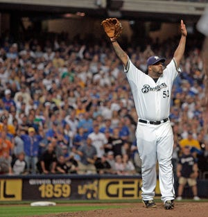 Milwaukee Brewers' CC Sabathia celebrates after beating the Chicago Cubs at Miller Park Sunday, September 28, 2008.