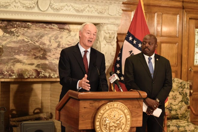 Arkansas Governor Asa Hutchinson speaks at a news conference regarding the impact of Arkansas Works and the loss of coverage for over 4,000 recipients.
