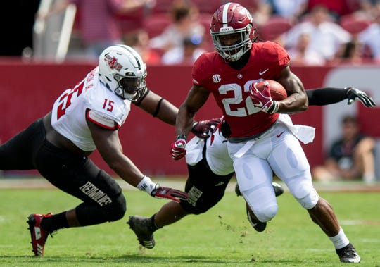 Alabama running back Najee Harris (22) carries in first half action against Arkansas State at Bryant Denny Stadium in Tuscaloosa, Ala., on Saturday September 8, 2018.