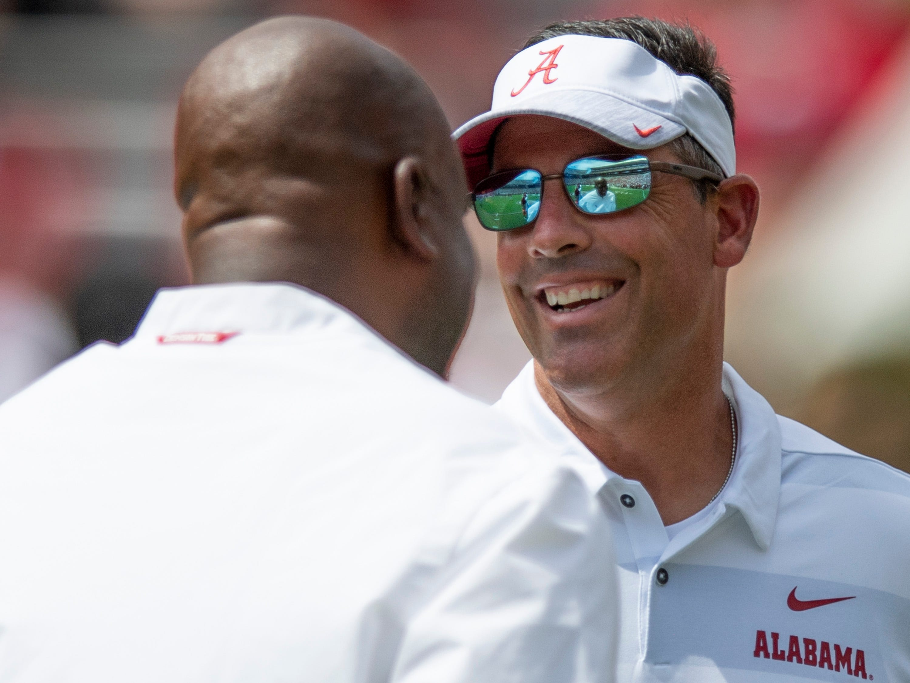 Alabama offensive coordinator Michael Locksley, left, and quarterbacks coach Dan Enos talk before the Alabama vs. Arkansas State game at Bryant Denny Stadium in Tuscaloosa, Ala., on Saturday September 8, 2018.