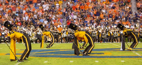 ASU's Mighty Marching Hornet drum majors lean way back as fans exploded in applause.