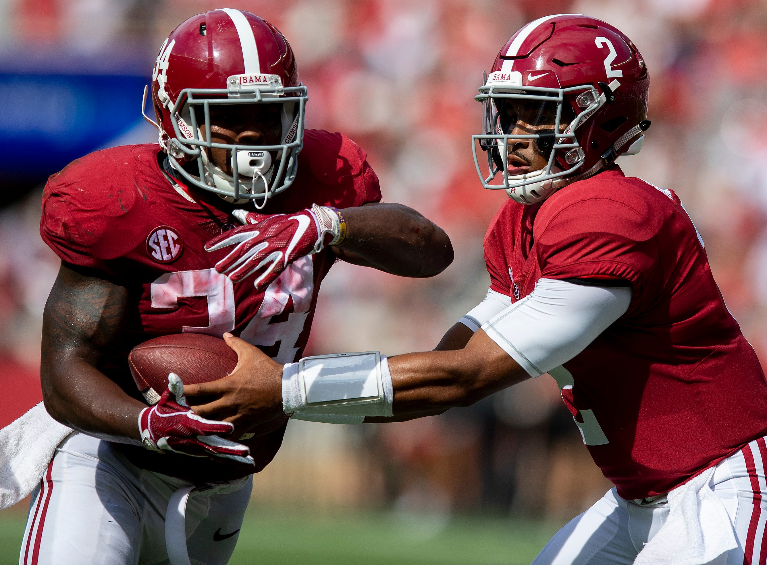 Alabama quarterback Jalen Hurts (2) ands off to Alabama running back Damien Harris (34) in first half action against Arkansas State at Bryant Denny Stadium in Tuscaloosa, Ala., on Saturday September 8, 2018.
