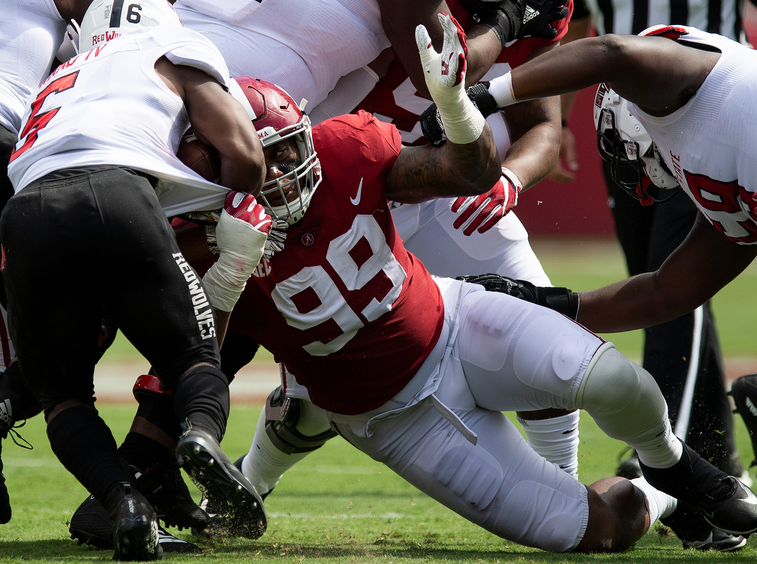 Alabama defensive lineman Raekwon Davis (99) tackles Arkansas State running back Warren Wand (6) In first half action at Bryant Denny Stadium in Tuscaloosa, Ala., on Saturday September 8, 2018.