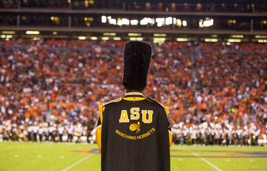 Before taking the field, a drum major of the Mighty Marching Hornets takes in the sight of the stadium.