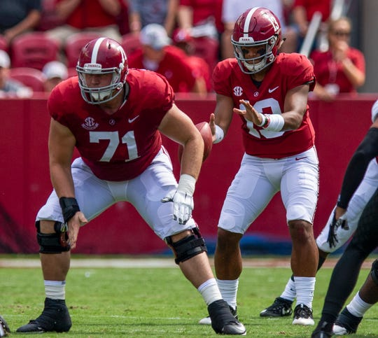 Alabama offensive lineman Ross Pierschbacher (71) and Alabama quarterback Tua Tagovailoa (13) in first half action against Arkansas State at Bryant Denny Stadium in Tuscaloosa, Ala., on Saturday September 8, 2018.