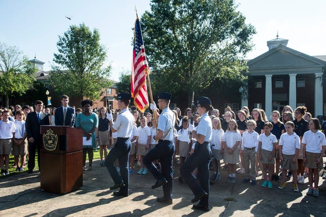 The color guard presents the flag during a National Anthem honor ceremony at St. James School in Montgomery, Ala., on Thursday, Sept. 13, 2018.
