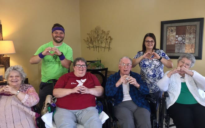 """A group of residents at Bethel Pointe Health and Rehabilitation Center in Muncie pose after finishing the """"Keke Challenge."""""""