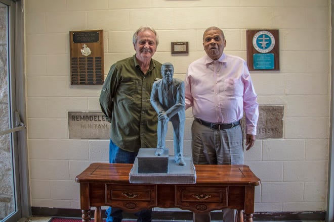 Artist Bill Wolfe (left) and Hurley Goodall stand by the draft of Goodall's statue.