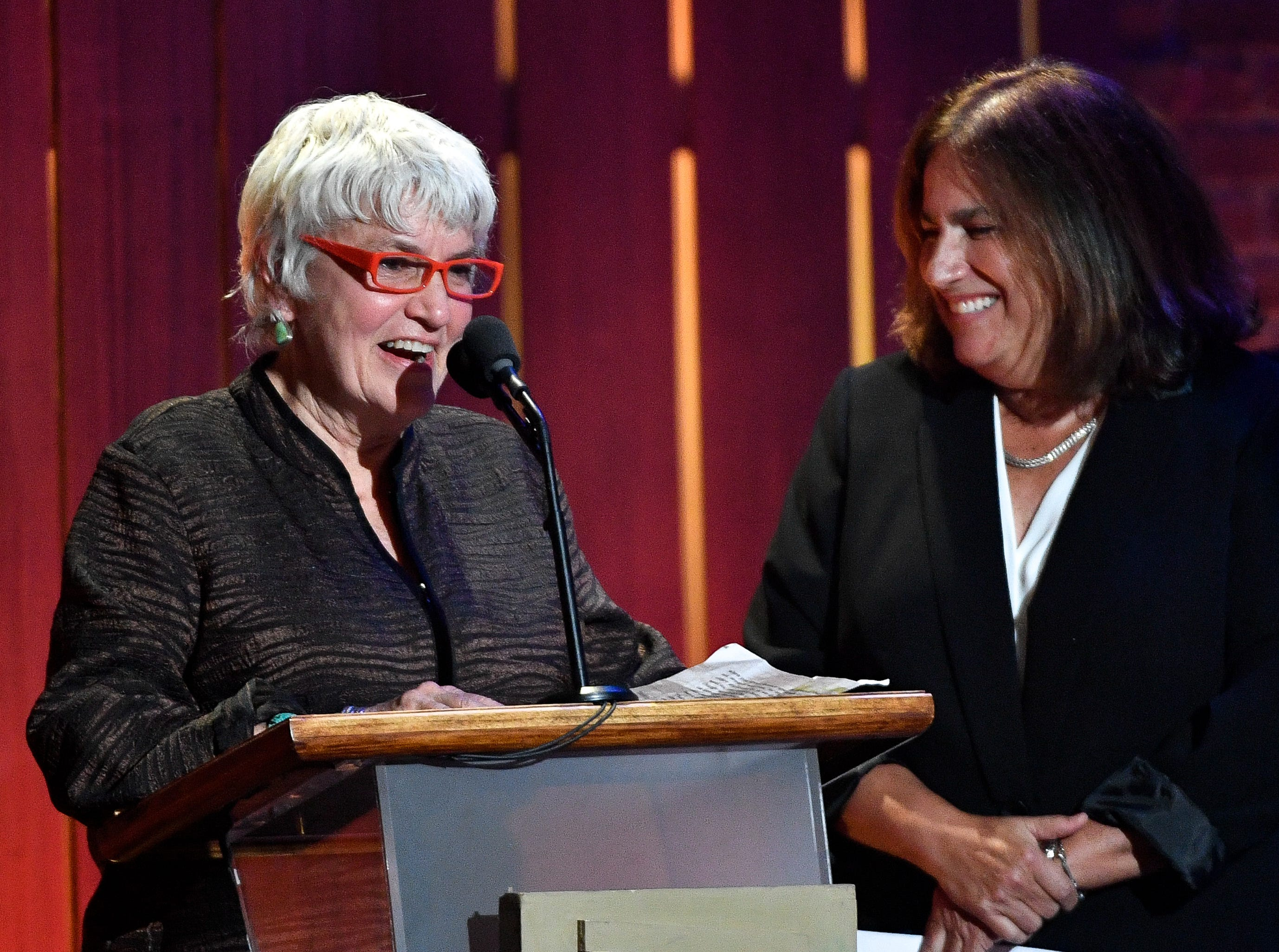 Cris Williamson, left, and Judy Dlugacz, right, accept the Lifetime Executive award during the 2018 Americana Honors and Awards show at the Ryman Auditorium in Nashville, Tenn., Wednesday, Sept. 12, 2018.